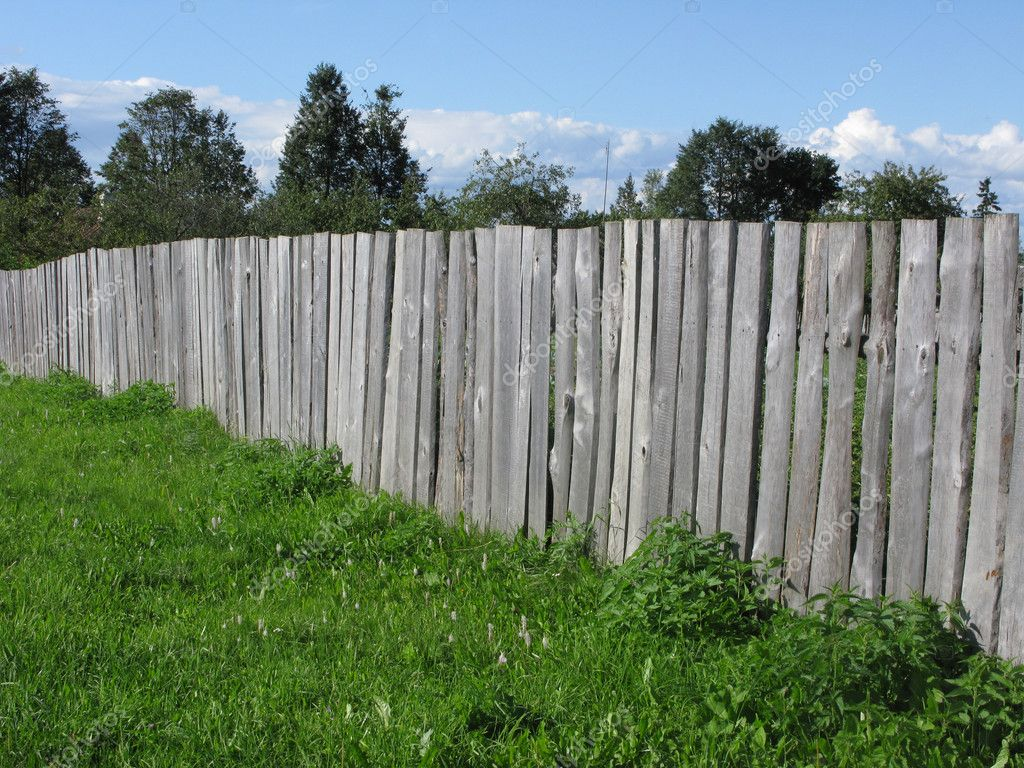 Fragment of old uncolored wooden fence — Stock Photo #1110277