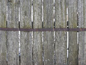 Old mossy wooden fence — Stock Photo