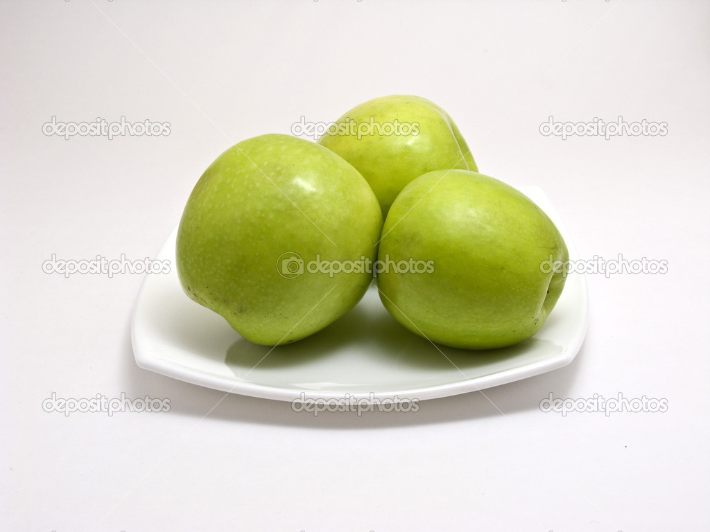 Three green apples on square dish isolated on white  Stock Photo #1165269
