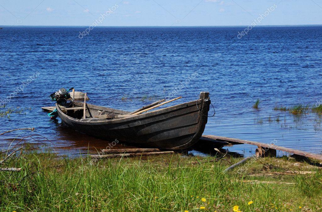 Old fishing wooden motor boat near the l — Stock Photo © viknik #1185661