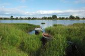Onega riverbank with boats in Kargopol — Stock Photo