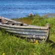 Stock Photo: Old wooden boat on lake bank