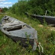 Old wooden boats on the ground — Stock Photo #1223695