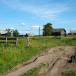 Ground road in northern russian village — Stock Photo