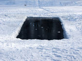 Ice-hole in frozen lake — Stock Photo