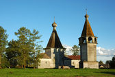 Wooden russian country church and belfry — Stock Photo