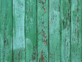 Green peeled wooden background — Stock Photo