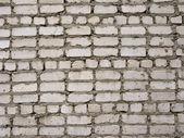 Old grey brick wall background — Stock Photo