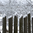 Old wooden fence under snow — Stock Photo