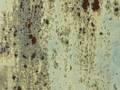 Green colored corroding metal background — Stock Photo