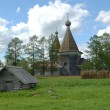 Ancient wooden russian country church - Stock Photo
