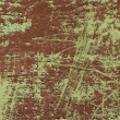Green colored scratched iron background - Stock Photo