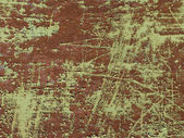 Green colored scratched iron background — Stock Photo