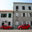 Two red cars — Stockfoto