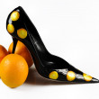 Royalty-Free Stock Photo: Women shoe with three oranges isolated o