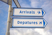Arrivals and departures signs — Stock Photo