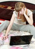 Female surfing the web on her bed — Stock Photo