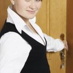 Woman open a door — Stock Photo #1194119