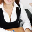 Smiling woman with pen — Stock Photo #1194312