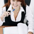 Smiling woman with pen — Stock Photo