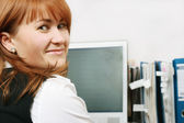 Woman in office smiling — Stock Photo