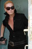 Model in sexy black ensemble — Stock Photo