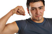 A bronze man is demonstrating his biceps — Stock Photo