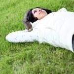 Beautiful girl lying down of grass — Stock Photo #1264655