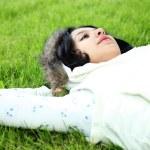 Beautiful girl lying down of grass — Stock Photo #1264693
