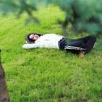 Beautiful girl lying down of grass — Stock Photo #1264883