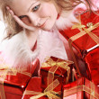 The portrait of the happy girl with gift - Stock Photo