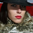 Stock Photo: Beauty female in hat with red lips