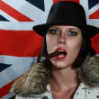 Stock Photo: Beauty female in hat smoking