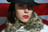 Beauty female in hat with red lips — Stock Photo