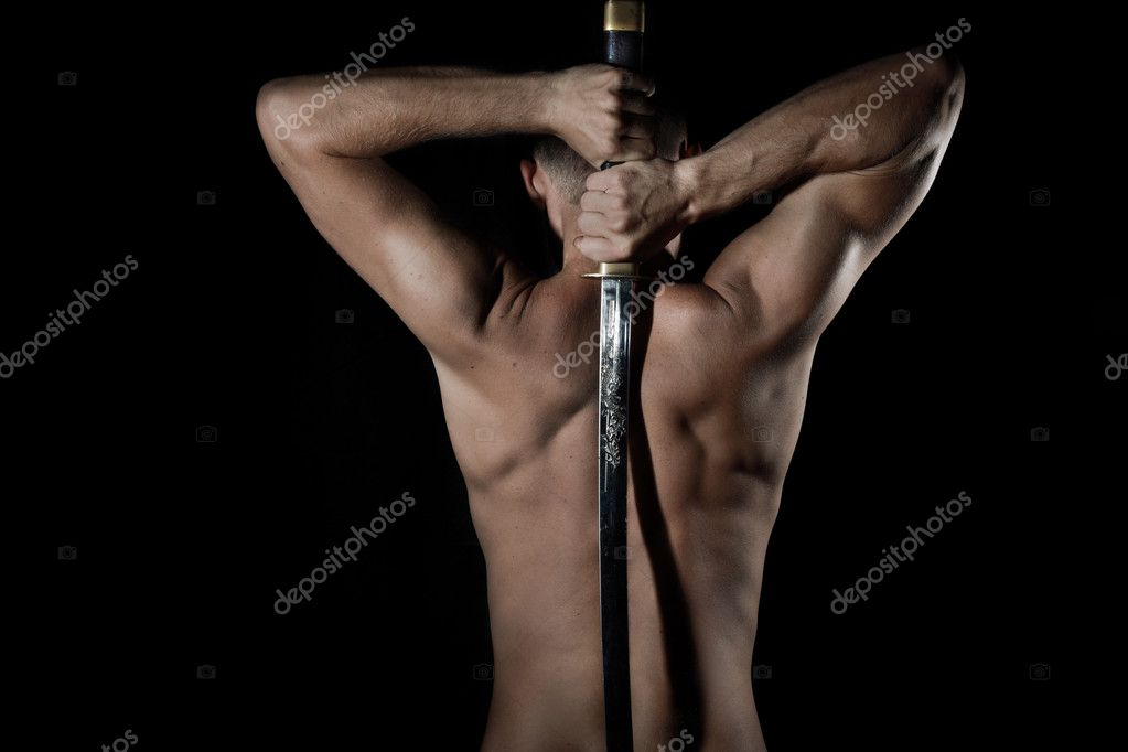 Silhouette of a young, handsome, healthy man with sword — Stock Photo #1306752