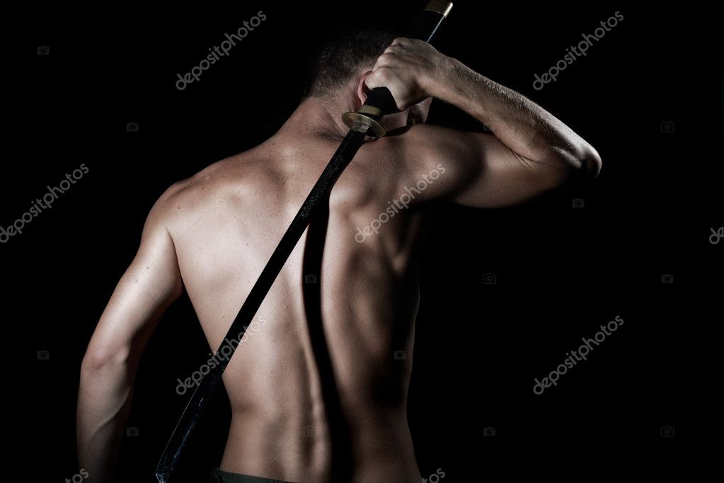 Silhouette of a young, handsome, healthy man with sword — Stock Photo #1306756