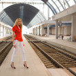 Pin up caucasian woman on railway statio — Stok fotoğraf