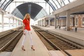 Pin up caucasian woman on railway statio — Stock Photo