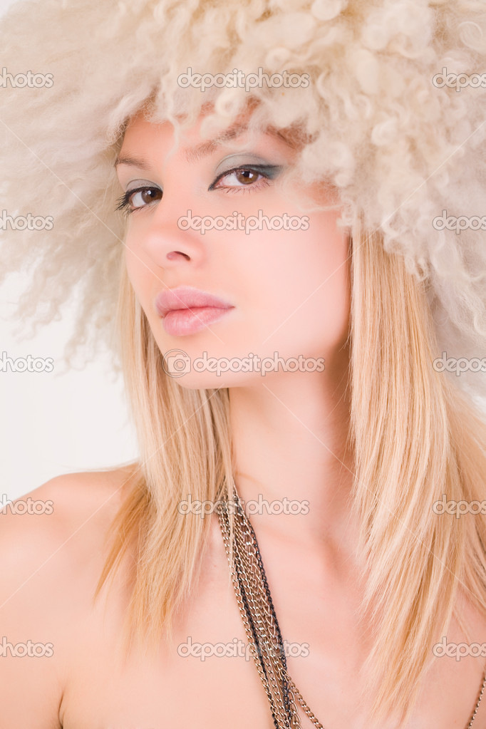 Portrait of beautiful girl in furry hat, close up shot  Stock Photo #1878339
