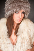 Woman with green eyes in furry hat — Stock Photo
