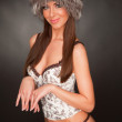 Playing girl in furry hat and lingerie — Stock Photo #2504254