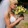 Happy bride with blond hair in a white wedding dress — Stock Photo