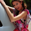 Brunette and a car — Stock Photo