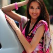 Brunette and a car - Stock Photo