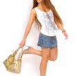 Girl with golden purse — Stock Photo #1117533