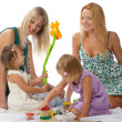 Mothers with daughters, play — Stock Photo
