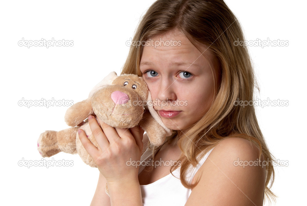 Portrait of a little girl with the fluffy hare in the hands of a white background  Stock Photo #1116208