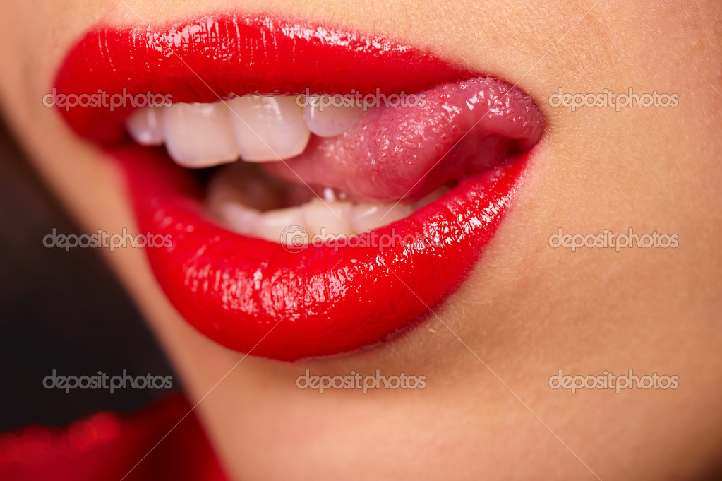 Close-up shot fat women's lips in red lipstick  Stock Photo #1116225