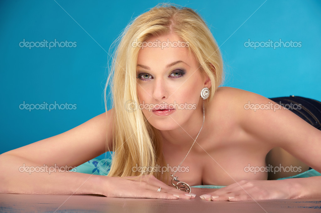 A young attractive blonde is naked on the floor  Stock Photo #1117484