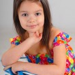 Stock Photo: Little girl resting on a chair